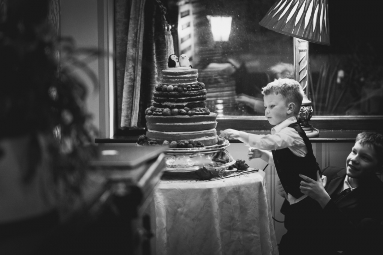 child stealing cake at oakwood hall yorkshire