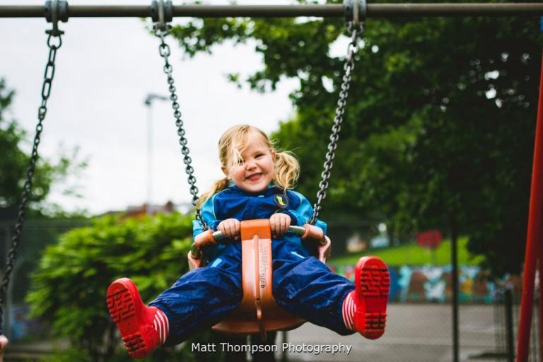 kids portrait photography on a swing