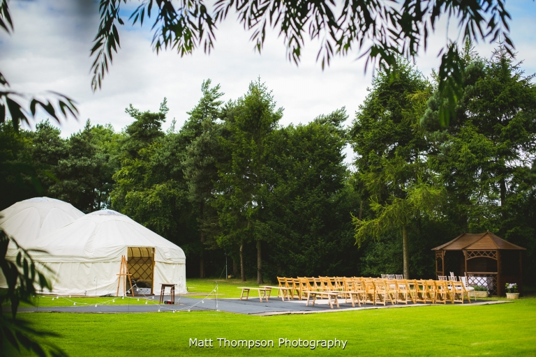 yurt and outdoor ceremony area