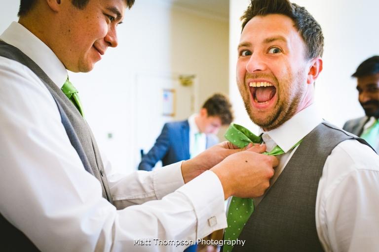 excited groom prep