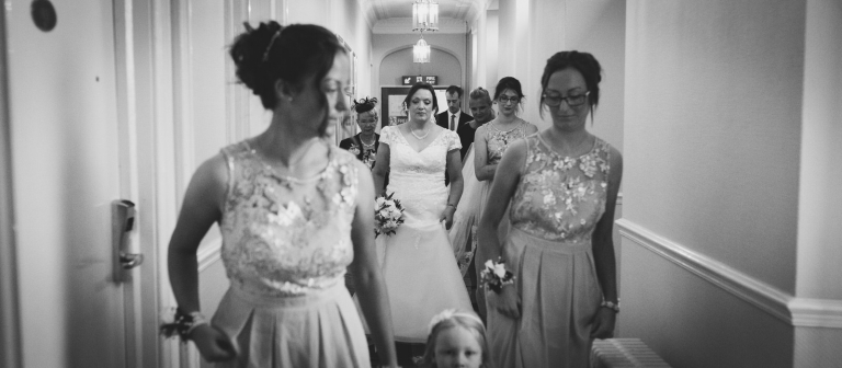bride walking down with bridesmaids