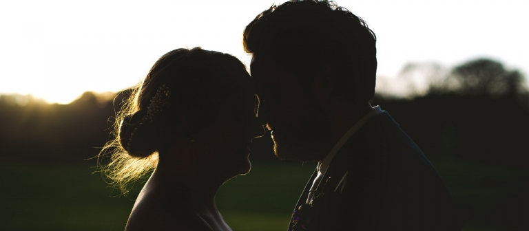 sunset silhouette wedding portrait