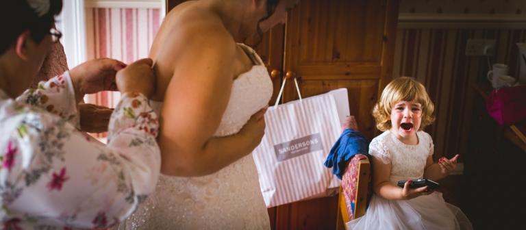 toddler crying at a wedding