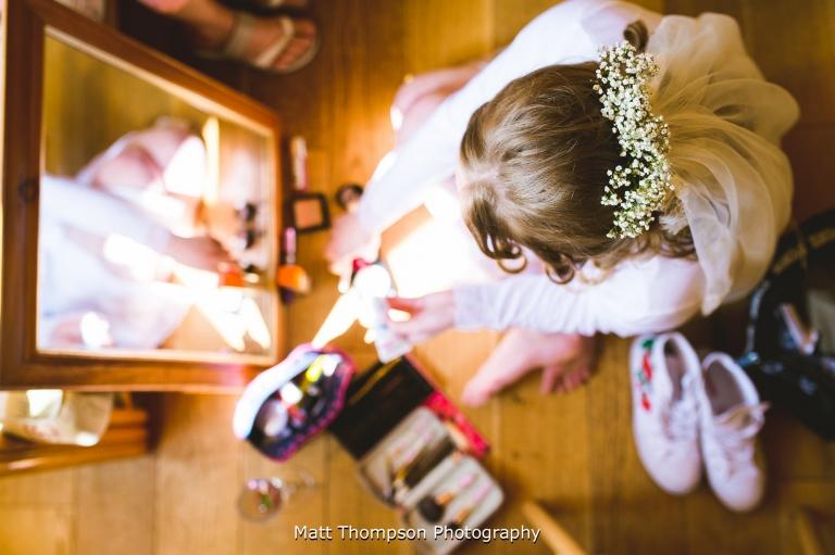 bride doing her own makeup