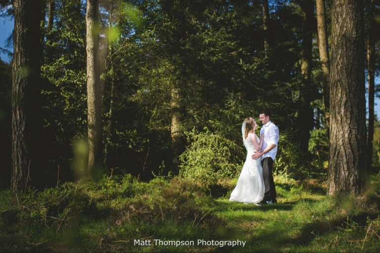 Bride and groom in th woods